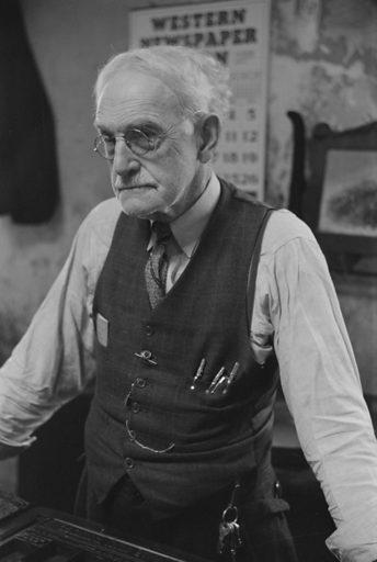 Mr McCutchins, editor of the local newspaper in Franklin, Heard County, Georgia. Date 1941 Apr.-May.