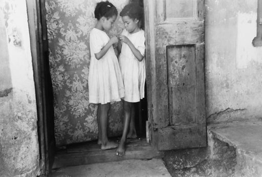 Children living in one of the substandard houses on a side street in Charlotte Amalie, St Thomas, Virgin Islands. Date 1941 Dec.