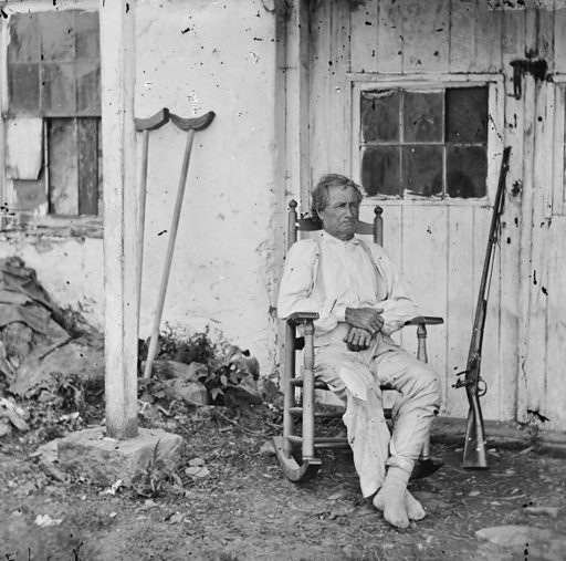 "Gettysburg, Pa. John L Burns, the ""old hero of Gettysburg,"" with gun and crutches. Photograph from the main eastern theater of the war, Gettysburg, June-July, 1863. Date 1863 July."