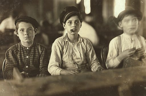 Young Cigarmakers in Englahardt & Co, Tampa, Fla. There boys looked under 14. Work was slack and youngsters were not being employed much. Labor told me in busy times many small boys and girls are employed. Youngsters all smoke (see 565). Witness Sara R Hine. Location: Tampa, Florida. Date 1909 January.