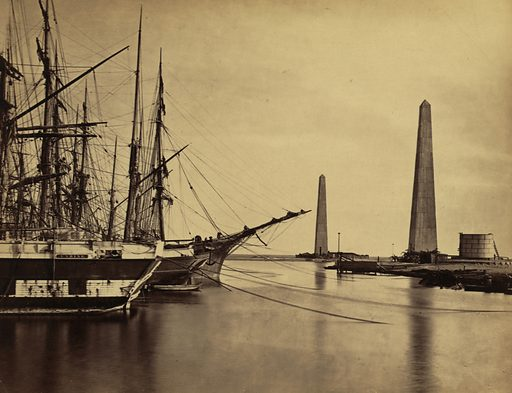 Suez canal entrance at Port Said. Obelisks on shore and ships moored at Port Said, the entrance to the Suez Canal. Date between 1856 and 1860.