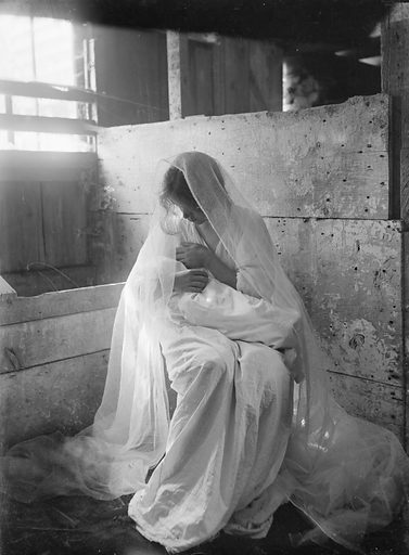 The Manger, an experimental negative to show values of white against white, featuring a young woman holding a baby and made in Newport, RI Date 1901.