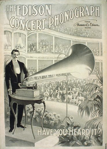 The Edison concert phonograph Have you heard it?. Advertising poster for Edison phonographs showing a man playing a phonograph on a stage before large audience seated in a grand concert hall. Date c1899.