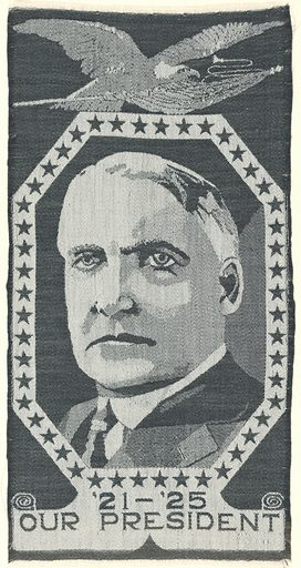 Black and white portrait ribbon of President Warren G. Harding in an elongated octagonal frame filled with stars. Eagle is on top of the frame. Inscription on the bottom reads: '21–'25 Our President. Made in: USA. Date: 1920s. Record ID: chndm_1955-53-1.