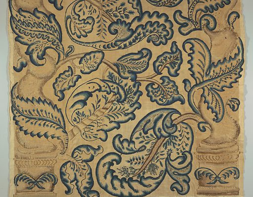 Vertical panel of crewel embroidery with a large-scale pattern of baroque twisted columns on high bases with crossed palms entwined with large-lobed leaves; twining branches and similar leaves fill space between. Embroidered in wool yarns in shades of brown, blue, and blue-green, on an undyed linen and cotton ground. Made in: England. Date: 1700s. Record ID: chndm_1955-144-2.