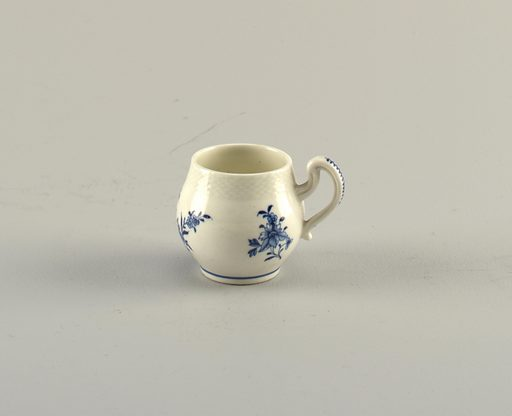 Barrel-shaped cup with round handle and molded basket-weave rim. Blue floral decoration and line at base. Date: 1720s. Record ID: chndm_1938-57-480.