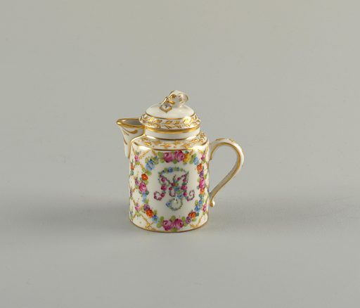 Cylindrical body and domed lid with gilded flower finial. Flower wreath encircling monogram. Short, wide spout. Date: 1800s. Record ID: chndm_1992-5-66-a_b.