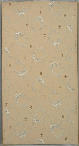 Floral wreaths connected by foliate vines interspersed with small floral ornament. Background of square dots. Beige ground. Printed in grey, white and metallic gold. Made in: New Brunswick, New Jersey, USA. Date: 1910s. Record ID: chndm_1979-91-644.
