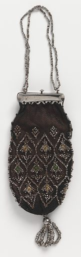 Flat purse of fine black net embroidered with cut steel beads arranged in point ovals and tent stitch in yellow and green silks. Fitted at top to steel frame with catch-chain of steels bands. Lined with pink taffeta. Made in: Europe. Date: 1830s. Record ID: chndm_1953-106-11.