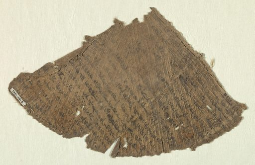 Grayish-tan plain cloth with stamped diagonal lines in relief. Rows of Arabic characters painted over entire surface. Two seams. Made in: Egypt. Date: 1100s. Record ID: chndm_1921-29-3.
