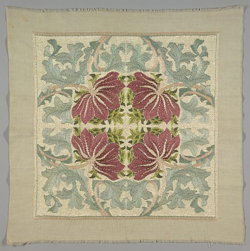 Embroidered cotton square intended as a cushion cover, with a vertically and horizontally mirrored pattern of a rose-colored flower with grass-green leaves, surrounded by pale blue acanthus leaves, after a design by William Morris. It was purchased as a kit in the Morris shop in London, and worked by the donor. Made in: USA. Date: 1900s. Record ID: chndm_1936-5-3.