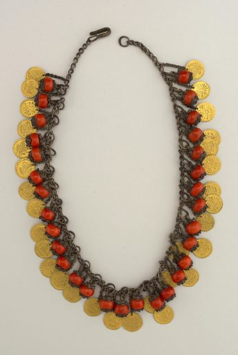 Silver chain with pendants of coral set in silver filigree alternating with gold disks. Made in: Turkey. Date: 1800s. Record ID: chndm_1931-6-182.