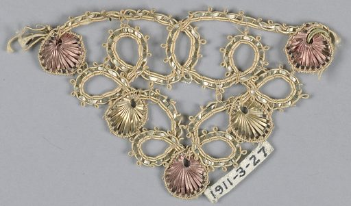 Trimming of white and pink silk cord and flat copper strips twisted into an ornamental design of loops. Made in: USA. Date: 1900s. Record ID: chndm_1911-3-27.