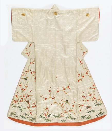 Woman's kimono of white silk satin with woven design of tiny lozenges, tortoises and phoenixes. Embroidered with silk threads in red, gold and green with cherry blossoms, pine branches, bamboo, phoenix and butterflies. Lined with red silk. Made in: Japan. Date: 1800s. Record ID: chndm_1931-4-65.