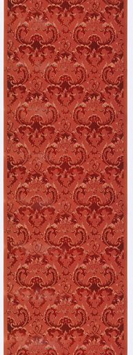 Scrolling acanthus pattern, with foliage forming repeating medallions. Printed in red and white on mauve ground. Made in: USA. Date: 1910s. Record ID: chndm_1979-91-595.