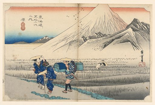 Fuji rising from a group of lower peaks on the far side of rice fields; its peak going above the upper line of the frame line. In the foreground, two women and a porter pass along the road to the left. Two cranes in the rice field. Made in: Japan. Date: 1820s. Record ID: chndm_1948-134-14.