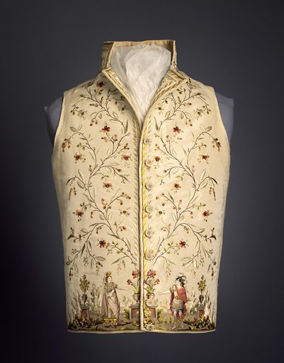 White silk waistcoat with high stand collar and straight hem edge. Very deep border at front edges of a curving, flowering vine. At the bottom, embroidered figures in classical dress stand in front of a stone balustrade with urns of flowers and fruit trees. The figures represent Dido, Queen of Carthage, and the Trojan hero Aeneas, from the opera by Piccini and Marmontel, produced in 1785. The figure of Dido is after a drawing by Jean-Michel Moreau le Jeune for the costume worn by Mlle. de Saint-Huberty. In twenty-five colors of silk. Made in: France. Date: 1780s. Record ID: chndm_1962-54-47.