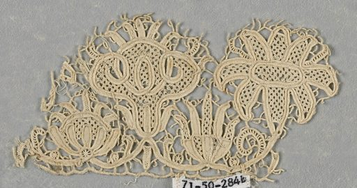 Fragments of a scalloped border formed by two alternating flowerheads. In spaces below flowers are two smaller flowerheads in an alternate arrangement. Made in: Italy. Date: 1700s. Record ID: chndm_1971-50-284-a_c.