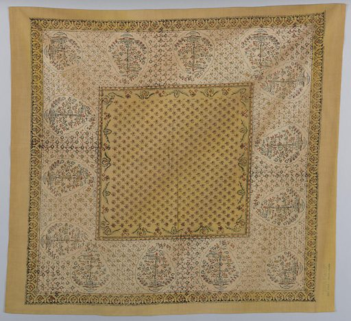 Handkerchief with a central yellow square and yellow border has a design of large paisleys in the off-white field. Paisleys are surrounded by small geometric pattern of squares, crosses, dots and dashes. Central yellow square has small red squares outlined in black and a border of a trailing flower and vine pattern. Made in: Tarascon, France. Date: 1900s. Record ID: chndm_1981-11-11.
