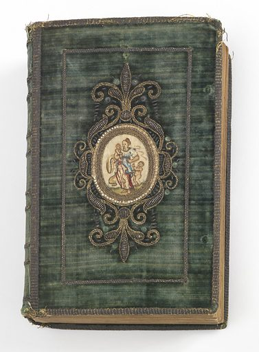 Book covered in green velvet with a central medallion embroidered in colored silks on white satin and enclosed by a ring of pearls within a heavy frame of metallic yarns, some raised. Different medallion on front and back. Made in: Amsterdam, Netherlands. Date: 1620s. Record ID: chndm_1983-86-1.