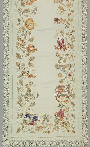 Seventeen embroidered gnomes walking on vines and leaves. Each carrying a different fruit, vegetable or objects such as: radishes, grapes, a wine cup, foaming beer mug, sausage, egg, carrots or turnips, cherries, wheat, mushrooms, strawberries, raspberries, lobster, and a barrel of wine dated 1890. Made in: Cologne, Germany. Date: 1910s. Record ID: chndm_1983-25-1.
