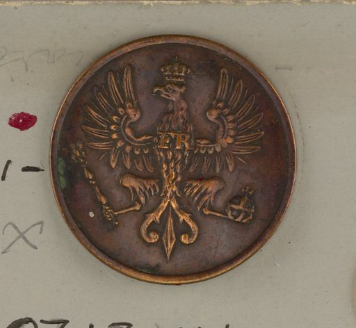 """A) Button ornamented with crowned eagle, spread and upcurling wings """"FR"""" on breast; orb in left claw, scepter, in right. Brass back and shank. B) Copper button in same design; """"extra fein"""" on reverse. Made in: Germany. Date: 1800s. Record ID: chndm_1931-59-108-a_b."""