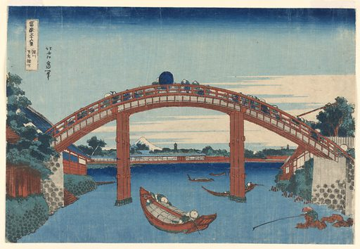 This landscape view features a crowded bridge, filled with pedestrians. Below, a body of water decorated with boats and fishermen. Located on the bottom right is a man sitting on a pile of rocks, fishing, alone. In the distance, snow-covered Mt. Fuji and two pagodas. This print is from the series, Thirty-six Views of Mt. Fuji (Fugaku Sanjuroku Kei). Made in: Japan. Date: 1820s. Record ID: chndm_1941-31-115.