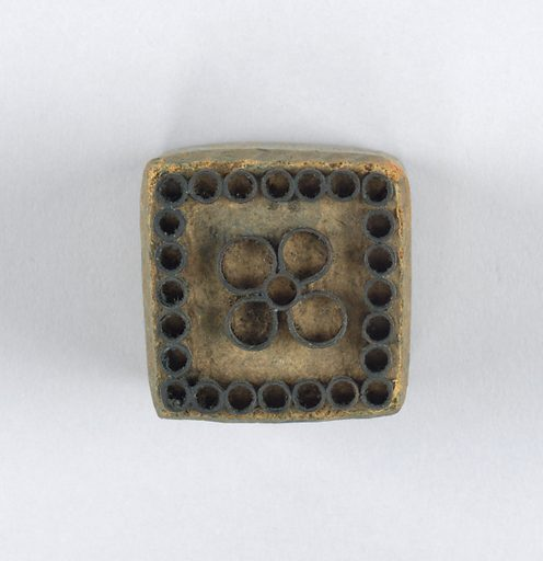 One of twenty-one wood blocks showing a different floral motif formed by metal strips set in wood. Made in: USA. Date: 1820s. Record ID: chndm_1941-87-1-l.
