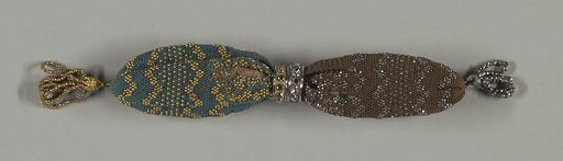 Netted in blue silk on one side, ornamented and tasseled at end with gold beads; brown silk ornamented with cut steel beads and tasseled with steel beads on other side. Two rings control side opening; on the blue side is a gold ring, on the brown there is a ring of cut steel. Made in: France. Date: 1810s. Record ID: chndm_1953-106-70.