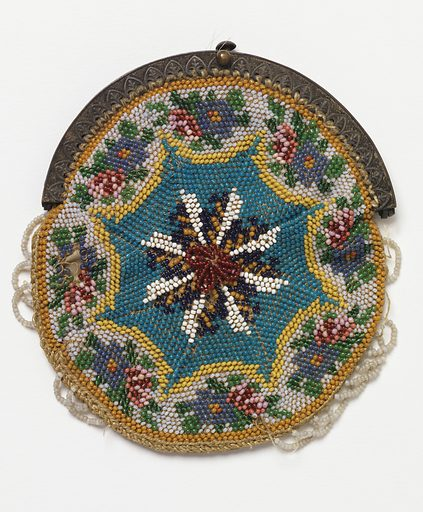 Knitted bag, circular in form, with an eight-pointed star in the middle with a floral border. Beaded scallops around edges; metal frame, silk lining. Made in: USA. Date: 1820s. Record ID: chndm_1944-57-16.