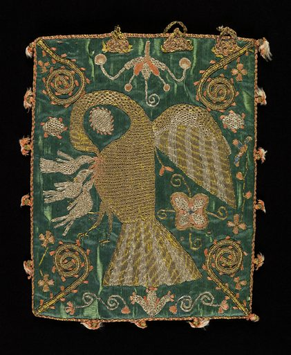 Flat rectangular bag of heavy green satin, embroidered in gold and silver metallic yarns and coral-colored silk. On one side the pious pelican is plucking her breast to provide sustenance for her young. Bishop's crooks point inward from the corners. On the other side, a stylized flowering branch in a pitcher, with animals and birds. The embroidery is worked through the satin into a heavy linen backing. Remains of loop and knot fastening at top; coral and gold cord edging, with small tassels at intervals; lined with coral silk taffeta. Made in: Spain. Date: 1700s. Record ID: chndm_1950-115-3.