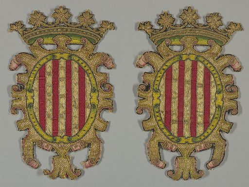 Oval shield with red and gold vertical stripes surrounded by gold arabesqued mantle, topped with crown with rosettes across top. Details of shaded pink and green satin stitch; black outlines. Made in: Spain. Date: 1500s. Record ID: chndm_1953-162-80-a_b.