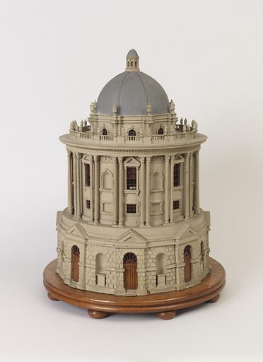 the circular building with rusticated lower tier supporting set back upper tier with double columns between window bays, alternating blind and paned windows, surmounted by a domed top with finials around and a spire above, all replicating the Radcliffe Camera building in Oxford England. Made in: England. Date: 1770s. Record ID: chndm_2014-39-1.
