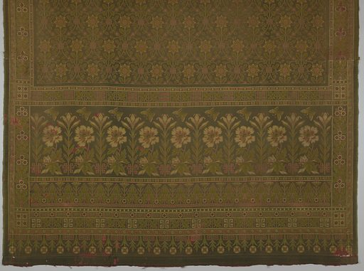 Woven hanging with a wide border at bottom and continuous pattern above in muted red, yellow,green and dark brown. The border contains a lilly, a chrysanthemum and a butterfly and the guard band below a lotus-like plant. The field has a repeating pattern with full-face blossoms on a line forming an S-shaped grid. Made in: England. Date: 1860s. Record ID: chndm_1985-101-1.