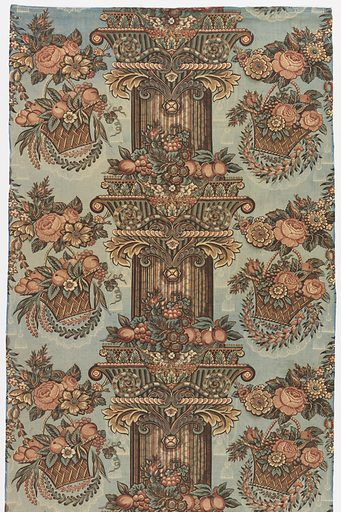 Pillar print showing a central fluted column banded by elaborate capitals and festooned with garlands of flowers and fruit on a blue ground. On either side is an alternating pattern of flower garlands and large baskets of flowers and fruit. The bold composition is complemented by a delicate pattern of tassels and lace swags in the background. Made in: England. Date: 1830s. Record ID: chndm_1978-167-3-a_b.