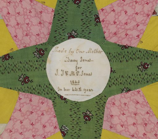 Small pieces of printed cotton in various colors patched to form a star medallion with scalloped outer edge. Each medallion set in white cotton about eighteen inches square. Twenty-five squares, each five by five inches, joined in a grid of strips of printed cotton, predominantly green. The center of each medallion plain white and several have handwritten inscriptions. Made in: Pennsylvania, USA. Date: 1840s. Record ID: chndm_1972-28-1.