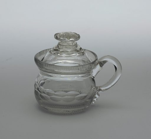 Round body with vertical fluted rim at top; loop handle; domed lid with button finial; body and lid cut with double row of printies, a row of narrow flutes at base of body. Date: 1810s. Record ID: chndm_1986-61-131-a_b.