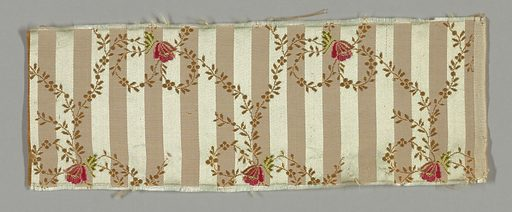 Ground narrowly striped vertically light blue satin and pale pink plain cloth. Over this a minute trailing vine, in secondary cream silk weft, looping into bow form and holding in knot a small bell-shaped blossom, which is brocaded in cerise, pink and green. Right selvage present. Made in: France. Date: 1890s. Record ID: chndm_1896-21-7.