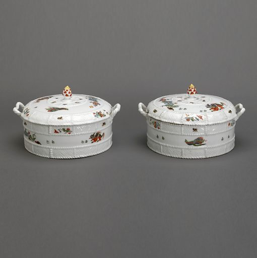 A white porcelain covered dish with a basket textured exterior. The covered dish has basket textured handles and an acorn knob. Date: 1730s. Record ID: chndm_1949-149-2-a_b.