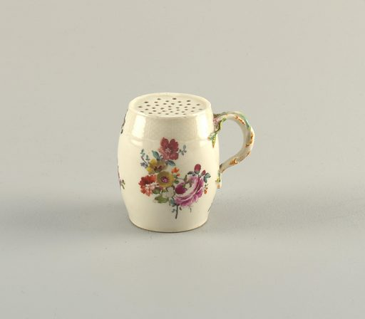 Barrel-shaped pot with molded basket-weave border. Perforated top. Handle modeled to resemble a twisting vine with flowers. Body decorated with floral bouquet. Date: 1770s. Record ID: chndm_1953-17-133.