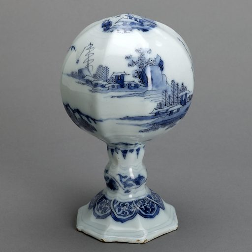Bulbous wig stand on a stem with octagonal foot. Chinoiserie decoration in cobalt. Blue tinted tin ground. Made in: Nevers, France. Date: 1740s. Record ID: chndm_1962-60-4.