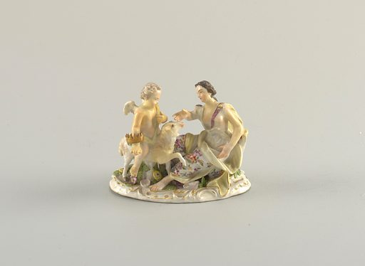 Figural group; a cherub with a grown on one arm rides a lamb to a seated female. Date: 1800s. Record ID: chndm_1967-92-13.
