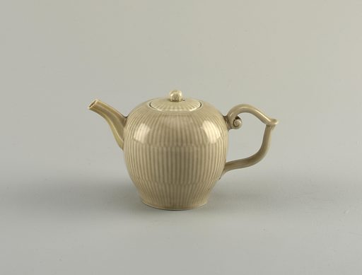 Celadon-glazed teapot molded with broken reeding pattern and with strapwork handle. Date: 1730s. Record ID: chndm_1984-135-3-a_b.