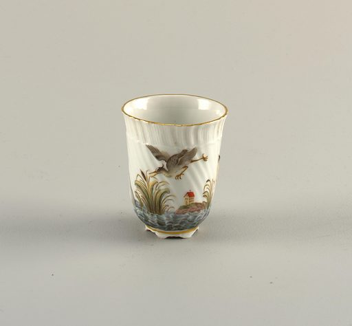 Beaker in the form first made in 1737 –1740 for the Swan Service. Painted decoration shows a bird in flight and a house on the shore. Date: 1800s. Record ID: chndm_1992-5-15.