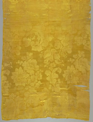 Yellow, large scale pattern with large flowers including daffodils. Date: 1880s. Record ID: chndm_1995-50-5-a_b.