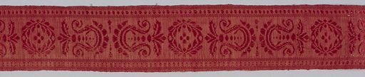 Fragment from curtain (rings still at top) of warm red, hard-surfaced wool, stamped in barely visible design of large all-over floral motifs. Bordered along one side by woven linen-and-silk strip in wreath and anthemioh design, also red. Made in: USA. Date: 1800s. Record ID: chndm_1958-148-13-c.