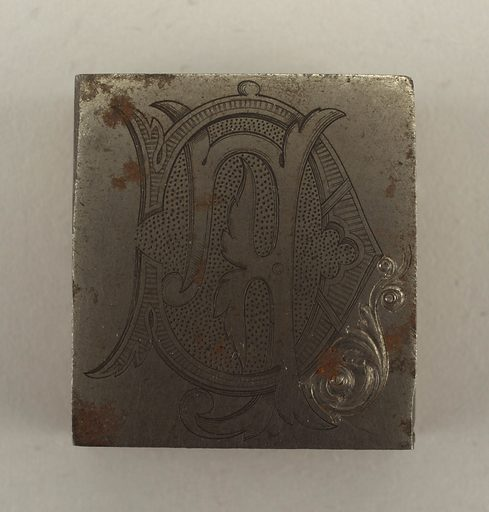 Rectangle engraved with a monogram CF, in reverse. Date: 1910s. Record ID: chndm_1942-80-21.