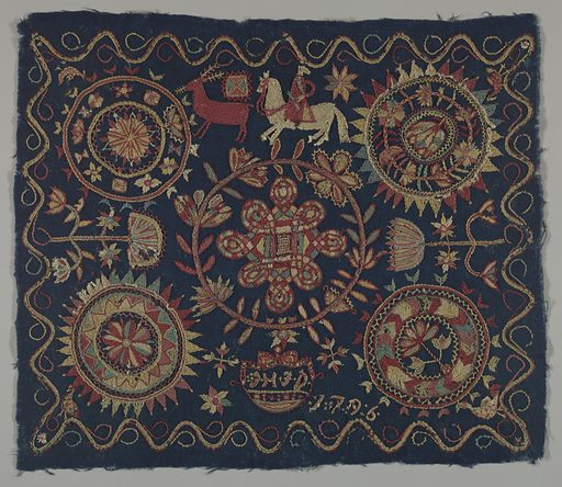 "Dark blue wool ground embroidered in coarse outline and filling stitches in polychrome wool yarns. The large central medallion has an interlace pattern inside a stylized floral wreath. Above this are a reindeer and horse and rider, and below it a pendant framing the initials ""JHJD."" A medallion in each corner contains a stylized floral pattern, and there is a continuous scrolling border around the four sides. The date 1796 appears near the lower edge. Made in: Sweden. Date: 1790s. Record ID: chndm_1953-34-21."