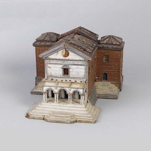 in the form of a Renaissance chapel abutting a brick building behind it, the chapel's front portico of single story, with three arches raised on double columns, surmounted by a single window in the wall, below an open triangular pediment, the back building with three roof tops. Date: 1700s. Record ID: chndm_2014-39-5.