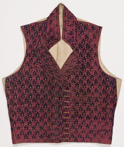 Gentleman's waistcoat made from velvet with an allover design of small leaf motifs in blue. Small rectangles of green and yellow decorate the center of each blue leaf. Made in: France. Date: 1800s. Record ID: chndm_1948-116-10.